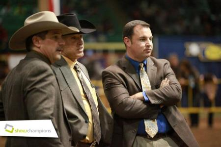 Chris Mullinix evaluating a class with rest the 2012 NWSS Jr. Market Beef judging panel.